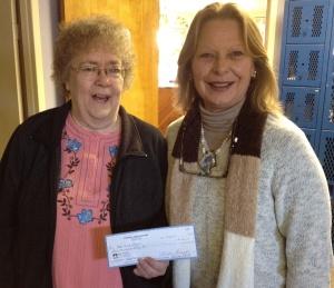 Sharon Ward presents the donation to Principal Sue Shepard.