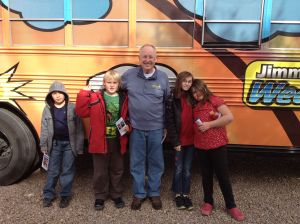 3rd-5th grade students outside the bus