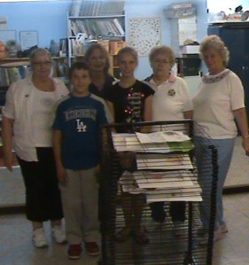 VFW Ladies Auxilliary presents drying rack to Principal Shepard and students.